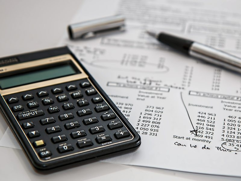 image of a calculator and papers laying on a table